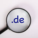 Magnifying glass with .de text