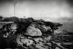 Lifting Fog over Botany Bay (Peter Polder) Tags: australia bw beach bay clouds morning sky laperouse light monochrome mono mist fog ocean overcast rocks sydney skyline seascape sea urban water waves