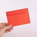 Hand holding red envelope