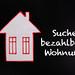 House with Suche bezahlbare Wohnung text