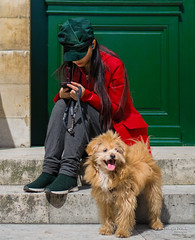 Street - Mistress and dog (François Escriva) Tags: street streetphotography paris france people candid olympus omd photo rue woman colors sidewalk red green sun cap beret coat shoes pet dog door hair sit sat tongue girl