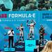 Lucas di Grassi, Sébastien Buemi und der französische Rennfahrer Jean-Éric Vergne feiern auf dem Siegerpodest auf einem Podium