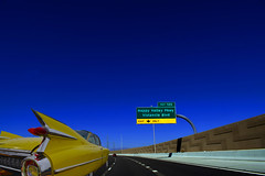 Passing Lane to Happy Valley Parkway (oybay©) Tags: loop303 arizonahighways vistancia color colors colorful retainingwall angle perspective light az arizona carshow car show generalmotors gm large finesse style grace taillight colour caddy caddie cad yellowcar tailfin automobile