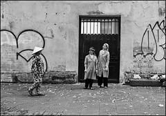 . (Out to Lunch) Tags: monastery street nuns door saigon ho chi minh city vietnam monochrome blackwhite wall pavement grafitti conical hat women leica me zeiss biogon 2835mm happyplanet asiafavorites