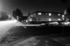 Santa Clara, California at night (bior) Tags: nikonf80 vivitar vivitar20mmf38 longexposure neopan neopan400 fujifilmneopan400 acros night street apartment traffic sidewalk santaclara california
