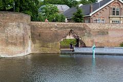 new entrance into the city (Ben van hulten) Tags: fortresswall wall bridge floatingbridge parkinggarrage undertheriver trees monuments shertogenbosch holland hole holeinthewall
