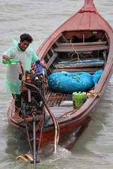 Fuel stop (leewoods106) Tags: man boat motorboat green ocean indianocean sea andamansea andaman water plastic engine southeastasia asia east fareast kohlanta oldtown kohlantaoldtown pier travel journey thailand island beautifulisland