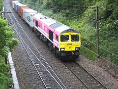 """Newly liveried Class 66 66587, in ONE """"Ocean Network Express"""" livery, and named """"As One, We Can"""" works 4L97, from Trafford Park to Felixstowe, passing Parsons Heath, Colchester on a rainy 12th June 2019. (dbidwell78) Tags: 66597 one ocean network express freightliner class 66 colchester container railway diesel locomotive shed"""