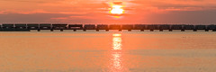 18-5476cr 1x3 (George Hamlin) Tags: ohio bay view railroad freight train norfolk southern westbound ns manifest lake erie sandusky water sunrise reflection silhouette colorful sky clouds bridge photodecor george hamlin photography crop letterbox panorama