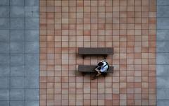 (cherco) Tags: man tokyo japan square solitario solitary architecture arquitectura seat composition canon composicion city ciudad calle silhouette silueta street orange minimalism minimalismo lonely light lines puzzle urban wait wa