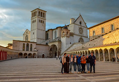 Padre and tourists (Mr.Dare) Tags: assisi umbria italia italy basilica church cathedral chiesa clouds storm sky pope medieval architecture building rain sunlight warm monk brother fratar dusk sunset