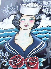 Manchester street art (rossendale2016) Tags: hygienic hygiene piercing pierce rings ear removal needles hot cold water ocean travel naval boats boat ships ship navy sailoress lady woman man two partner roses red waves seaside actress white cap sea sailor poster imaginative centre central city laser fashioned old above shopfront jewellery body shop tattoo clever artistic icon iconic quarter northern oldham art street manchester
