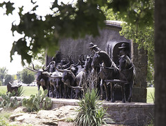 On the Chisholm Trail Monument by Paul Moore (cthcart) Tags: chisholm trail heritage center blue sky clouds duncan oklahoma top ten western museum history tourist destination paul moore thomas mccasland bronze monument sculpture american cowboy chisholmtrailheritagecenter travel