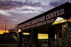 Sunset at Chisholm Trail Heritage Center (cthcart) Tags: weather publicart art cowboy american monument bronze sculpture paulmoore travel chisholmtrailheritagecenter destination tourist history museum western ten top oklahoma duncan clouds sky blue center heritage trail chisholm sunset portico garisgalleryoftheamericanwest