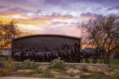 Sunset over the On The Chisholm Trail Bronze monument (cthcart) Tags: weather publicart art cowboy american monument bronze sculpture paulmoore travel chisholmtrailheritagecenter destination tourist history museum western ten top oklahoma duncan clouds sky blue center heritage trail chisholm sunset cactus landscape