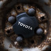 Close-up of a TOYOTA lettering on a rusty wheel rim
