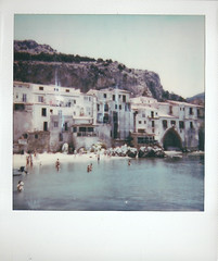 p600 - cefalu beach (johnnytakespictures) Tags: polaroid polaroidoriginals impossibleproject supercolor supercolor635 instant instantfilm integral p600 color600 siciliy sicilia italy italia holiday summer film analogue cefalu beach seaside ocean sea sand mediterranean coastline landscape swimmers swimming swim building period buildings architecture mountain mountains