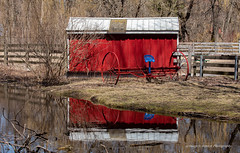 Red sees Red (superedge519) Tags: red barn reflections blue water farm equipment spring calm newfoundland boathouse