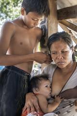 Labogon in Mandaue - Mother and sons (Mio Cade) Tags: mother son children breastfeeding baby toddler love family labogon mandaue cebu documentary reportage asia broomfactory portrait