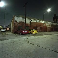 Red, yellow (ADMurr) Tags: la eastside night two cars hasselblad 500cm 50mm distagon zeiss fuji 400 pro 6x6 square mf dbb001