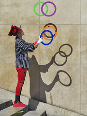 The shadows of the juggler (pivapao's citylife flavors) Tags: paris france trocadero streetartist