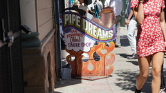 Pipe Dreams (Lynn Friedman) Tags: sanfrancisco people urban sign store sidewalk haightashbury 94117 pipedreams red woman shortdress