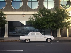 East Bay Native (misterbigidea) Tags: auto street urban building classic ford beauty car vintage cityscape parking scenic falcon parked dailydriver hotwheels architecture dusk circles tree downtown oaktown indahood