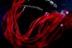 Foolish Heart (mariola aga) Tags: pendant glass heart ribbons multiplyexposure doubleexposure red black bokeh art