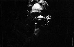 Nikon F shop window mirror (Monochrome Street) Tags: nikonf nikon analog film kodak kodaktrix 50mm diy selfdeveloped ai nikkor selfie mirror grain portrait yamankonuralp monochrome blackandwhite hc110 artistic contrast noir dark