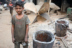 Bangladesh, shipyard in Dhaka (Dietmar Temps) Tags: asia bangladesch bangladesh bengali boy burigangariver childlabor childlabour childworkers dhaka dockyard industry naturallight outdoor people shipbuilding ships shipyard southasia tradition traditional vessel worker