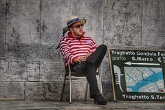 The Gondolier's Fag Break (FotoFling Scotland) Tags: 500px belluomo cigarette fag fagbreak flickr fotografiadistrada gondolier gondoliere hat italia italy seated sigaretta streetphotography venezia venice venzia