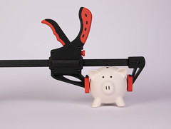 Piggy bank and clamp on white background (wuestenigel) Tags: clamp finance bank piggybank money plan whitebackground concept saving object office budget business cheap white cutout ausgeschnitten isolated isoliert noperson keineperson studio equipment ausrüstung handle griff steel stehlen tool werkzeug art kunst plastic kunststoff weapon waffe wire draht toy spielzeug danger achtung technology technologie pliers zange saw sah one ein instrument stilllife stillleben2019 2020 2021 2022 2023 2024 2025 2026 2027 2028 2029 2030