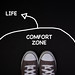 Step out of comfort zone concept