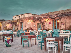 Marzamemi, Sicily - January 01, 2018: View of a typical restaurant in Marzamemi at sunset. Marzamemi, Sicily (giuseppepiazzese) Tags: blue clouds estate hot italia italy landscape mare mediterraneansea panorama panoramic panoramicview sea seaside sicilia sicily sky storia summer water nature background horizon clear travel paradise sun sunlight calm church day houses hystoric old religious square street marzamemi borgo town ancient piazza chiesa stone rock palace historic momument wall history fort fortress tonnara building landmark architecture tourism