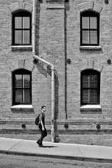 Bend (Mark Heine Photos) Tags: view guy building street person streetphotography humour california man sanfranciscobay sanfrancisco architecture old humanelement blackandwhite fishermanswarf streetsofsanfrancisco