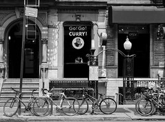 Go Go Curry (Kenneth Laurence Neal) Tags: newyorkcity urban street streetphotography streetphoto people bicycles restaurant blackandwhite blackdiamond monochrome monotone nikon noir contrast nikond5200 nikon35mm18