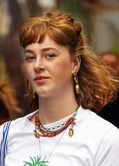 Portrait (D80_536465) (Itzick) Tags: denmark copenhagen candid color colorportrait redhead redhair earrings youngwoman necklace streetphotography face facialexpression finger portrait d800 itzick