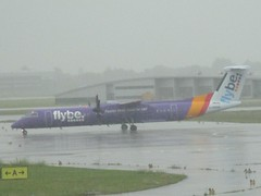 FlyMayBe in the Rain (cessna152towser) Tags: flybe bombardier q400 amsterdam schiphol