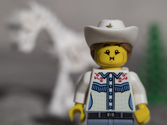 The Cowgirl is worried about the future of Wild Horses (DayBreak.Images) Tags: tabletop toys lego minifigures cowgirl skeleton horse tree canoneosm mirrorless 7artisans35mmf12 extensiontube manfrottolumimuse lightroom