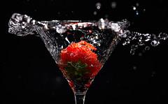 Strawberry (Bernie Condon) Tags: splash red black glass strawberry water flash studio
