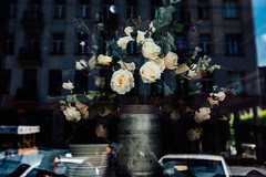 Everything in its place (ewitsoe) Tags: city moments nikond750 sigma35mmart spring street travel warszawa citylife erikwitsoe everydaylife living poland urban warsaw roses window display restuarant cafe reflection service night evening displayed flowers floral arrangement