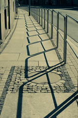 Fency Progression (youdoph) Tags: street boulevard shadow fence city sun light architecture urban