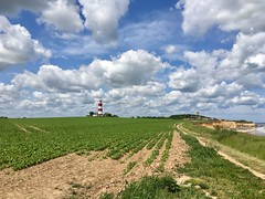 Big Sky with House & Church (MickStonedAgain) Tags: field white green tower church lighthouse happisburgh bing yahoo light peaceful calm atmosphere air dark google rocks setting west photographer snaps red iphone apple contrast waves cliffs clouds sky sea glow orange uk trees blue