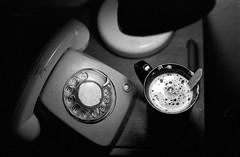 Esperando una llamada (Diego Leon y Bethencourt) Tags: minolta madrid x300 samyang df400x street photography fotografia de calle procesion lavapies cuatro torres españa black white blanco y negro rokkor 50 17