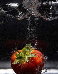 Strawberry (Bernie Condon) Tags: strawberry splash water drops drop red black sink flash studio