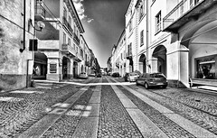 All roads lead ... to Via Roma  (Fossano, Piedmont, Italy). (Federico Fulcheri Photo) Tags: federicofulcheriphoto©️ italy piedmont fossano arch town stone tourism travel building architecture blackandwhite road street car city snapseed outdoors canonitalia canon