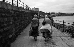 Can you imagine us, years from today... (Mano Green) Tags: people person sea promenade front seaside coast water east scarborough town yorkshire england uk summer september 2016 canon eos 300 40mm 35mm film ilfosol s spson perfection v550 black white landscape women bay