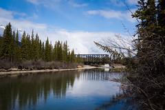 Canmore, Alberta (ellieupson) Tags: canmore river bridge alberta canada trees water sky blue landscape