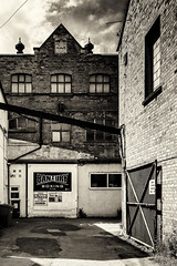 Banbury streets - Boxing (toniertl) Tags: houses urban blackandwhite bw streets monochrome architecture quiet gritty lives familiar ordinary midlands nothinghappening toniphotoxoncouk brick gate industrial decay repurposed boxingclub