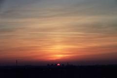Duel au Soleil (michel nguie) Tags: city sunset red sky orange sun film clouds analog shadows ciel nuages crépuscule beaulieu aurore roubaix aube rbx wattrelos michelnguie buildings ombres